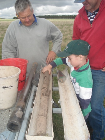 James and Hamish Draffin looking at their soil taken from their lime trial